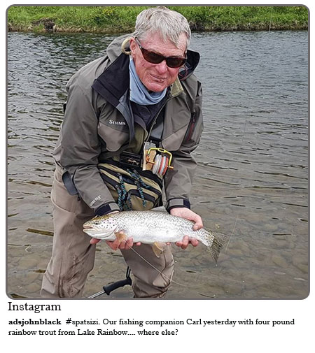 Spatsizi- Our fishing companion. Carl yesterday with four pound rainbow trout from Lake Rainbow ...where else?