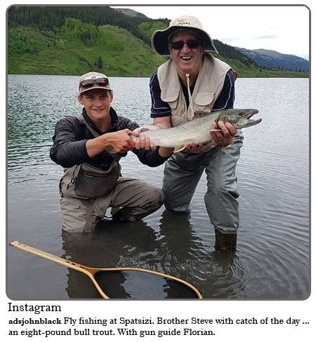 Fly fishing at Spatsizi. Brother Steve with catch of the day...an eight pound bull trout. With gun guide Florian.